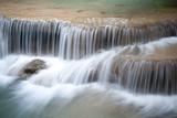 Fototapeta przepływające - rzeka - Kaskada / Wodospad / Gejzer