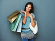 Happy brunette holding shopping bags