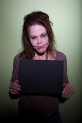 Frustrated woman taking mugshot