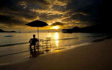 Person relaxing and watching sunset