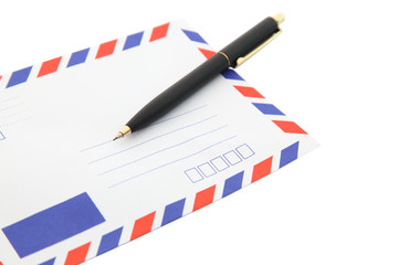 closeup of isolated air mail envelope with pen