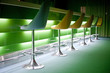 Chairs in row with green lights