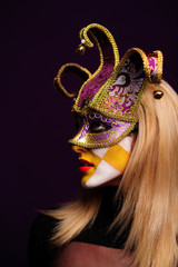 woman in violet half mask