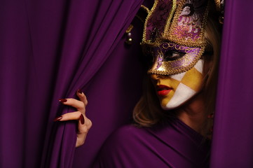 pretty young woman in violet mask