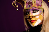 calm woman in violet party mask