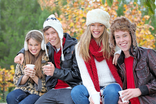 happy autumn winter or fall group of teens