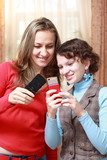 Two girls with mobile phones