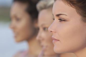 Three Beautiful Young Women In Profile