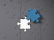 A blue puzzle piece on grey pieces