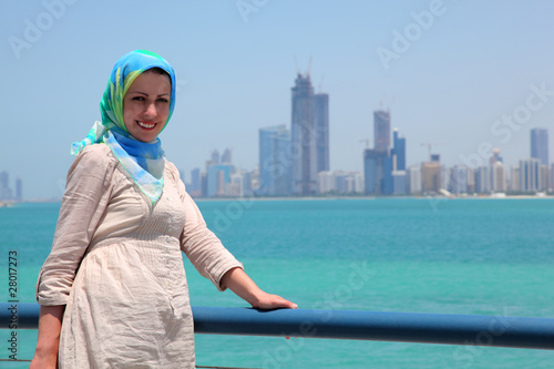 Smiling girl in blue kerchief standing on the ship