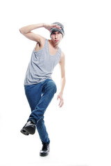 studio portrait of young hip-hop dancer over white