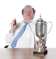 cliché de business man au trophée