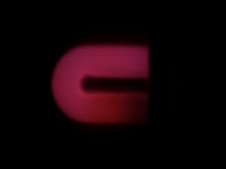 Blurred image of the source of the neon light