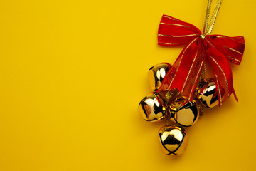 Christmas Bells On The Yellow Background