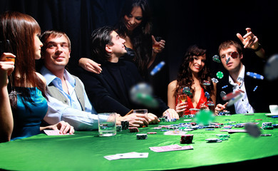man throwing chips on the table while playing cards
