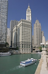 Chicago River passenger boat and Wrigley Building