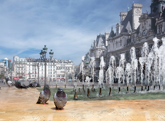 Kind on a fountain with pigeons against the mayoralty in Paris.