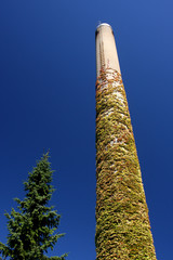 High chimney in a blue sky in denmark