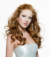 Beautiful woman with long curly-headed hairs