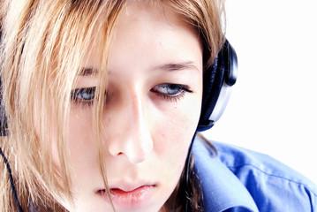 Young girl in headphones being sad