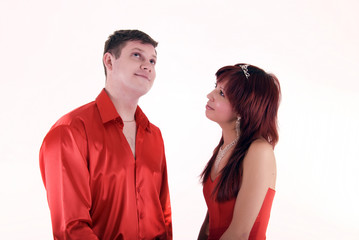 Young couple in red has fallen out