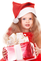 Child  in red santa hat holding gift box. Isolated.