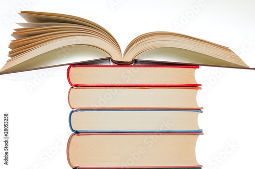 Stacked books on the white background