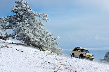 Off-road car (with removed trademarks) on winter landscape