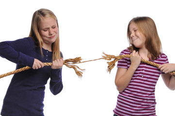 Two girls fighting over a rope