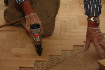 Laying wooden parquety flooring