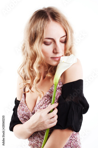Beautiful blond girl with fresh flower