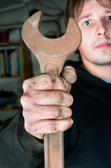 Worker holding spanner