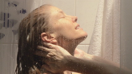 Woman washing in shower