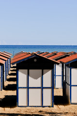 Multiple beach cabins
