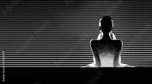 black and white back view artistic nude, on striped background