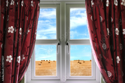 Window and curtains with view of crops