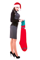 Business woman in black dress and hats of Santa Claus