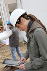 Woman engineer helmet standing on construction site