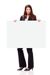 Young business woman holding billboard