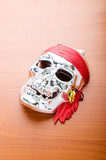 Skull mask isolated on the wooden background