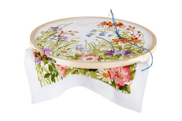 Embroidery of a picture with the image of colours, on a white ba