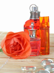 Perfume bottles with rose and glass pebbles