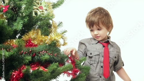 Video with cute boy decorating Christmas tree