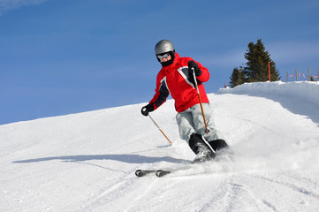 Young boy skiing on mountains