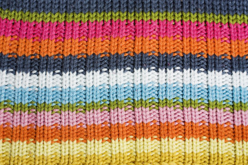 Closeup of colorful knitted wool texture.
