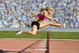 Fototapety Track and Field Hurdler Athlete