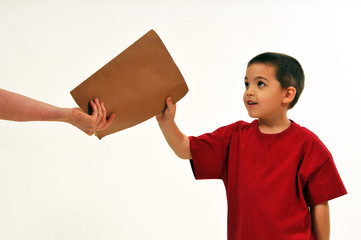 Boy receiving a report in a folder