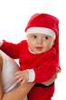 Kleines Baby als Weihnachtsmann