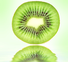 Kiwi closeup on green background