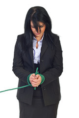 Sad business woman tied up
